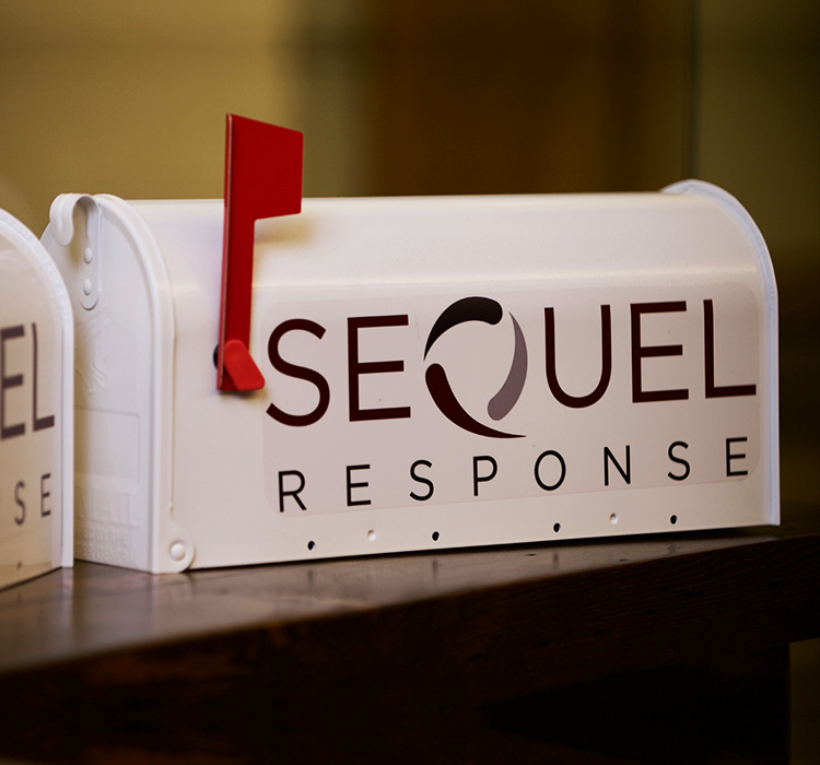 White mailbox with SeQuel Response logo