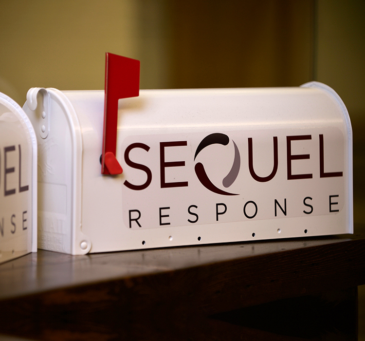 SeQuel Response logo on white mailbox