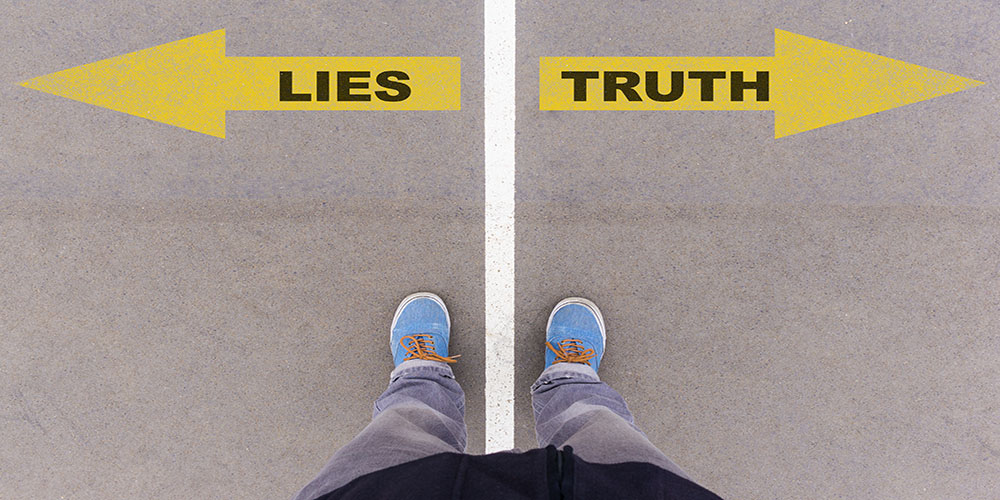 Lies vs truth text on yellow arrows on asphalt ground, feet and shoes on floor, personal perspective footsie concept